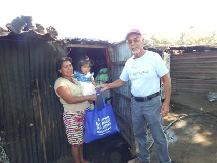 Ramiro Deliving Food bags at MIgrant Camp